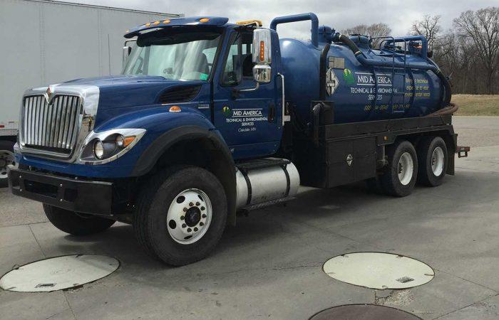 Blue Vacuum Truck